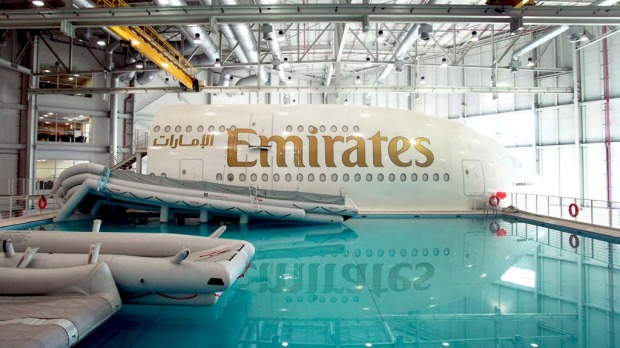 Aircraft emergency escape shoots extend into the training pool, next to an Emirates Airline simulator.