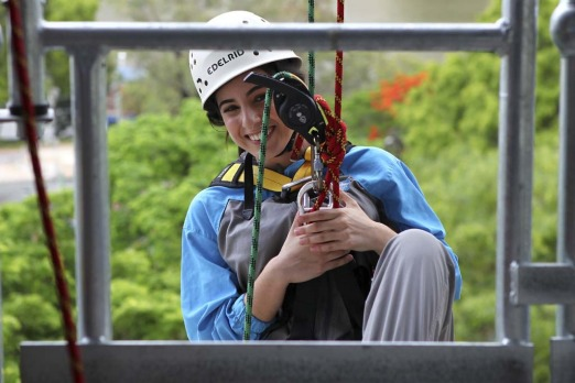 Marissa Calligeros begins her abseil from the Story Bridge.