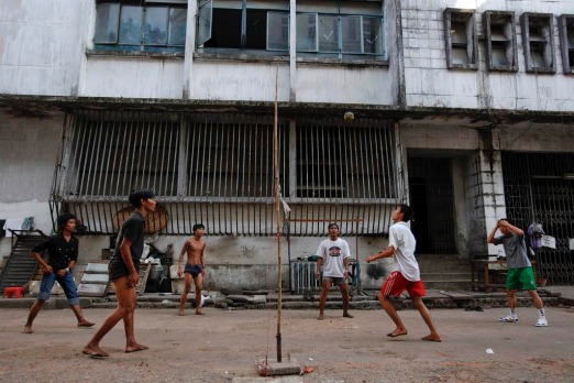 People play a ball game in Yangon. Myanmar's former capital and biggest city Yangon is a crumbling monument to almost ...