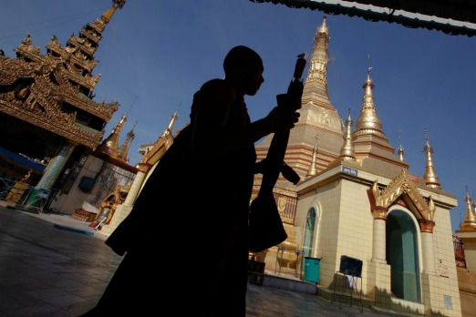 A Buddhist monk walks at Sule Pagoda in Yangon. Myanmar's former capital and biggest city Yangon is a crumbling monument ...