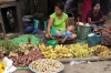 A fruits vendor waits for customers at a local bazaar in Yangon. Myanmar's former capital and biggest city Yangon is a ...