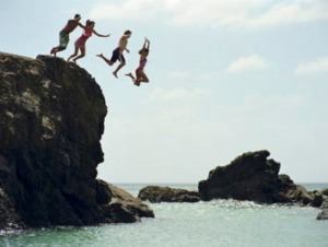 Taking the plunge in New Zealand's Northland.