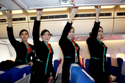 Thai transsexuals flight attendants, from left to right, Chayathisa Nakmai, Nathatai Sukkaset, Phuntakarn Sringern and Dissanai Chitpraphachin pose inside a PC Air plane.