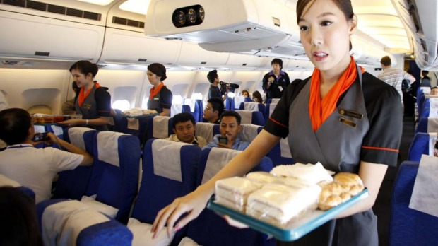 PC Air transsexual flight attendant Chayathisa Nakmai, 24, serves passengers.