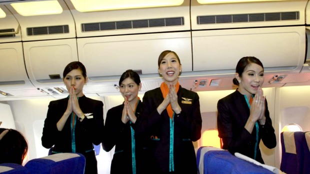 Thai transsexual flight attendants, from left to right, Phuntakarn Sringern, Nathatai Sukkaset, Chayathisa Nakmai and Dissanai Chitpraphachin, greet passengers.