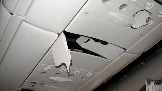 Damage to the fittings above passenger seats caused by the plunge of the Qantas flight.