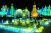 Tourists visit ice sculptures during the lights testing period of the 13th Harbin Ice and Snow World in Harbin, ...