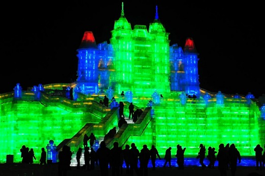 Tourists visit ice sculptures during the the lights testing period of the 13th Harbin Ice and Snow World in Harbin.
