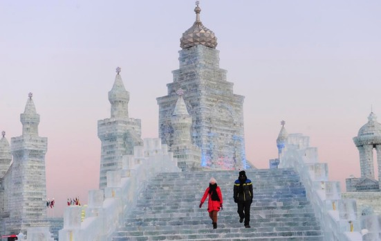 Tourists visit ice sculptures during the testing period of the 13th Harbin Ice and Snow World in Harbin, Heilongjiang ...