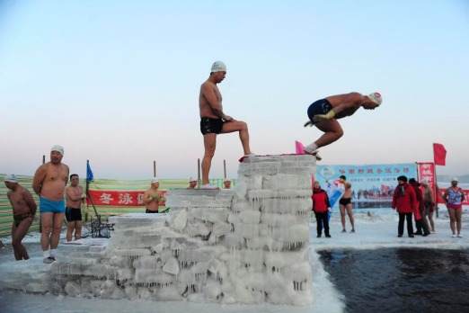 Winter swimmers prepare to jump into the icy water of the Songhua River in Harbin, Heilongjiang province.