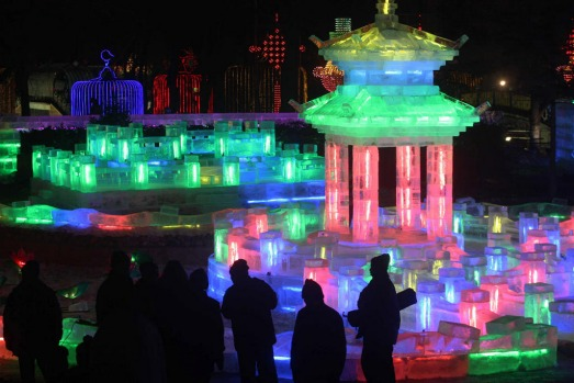 People visit the Harbin Ice-Lantern Show at Zhaolin Park  in Haibin, Heilongjiang Province of China.