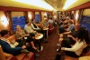 Guests enjoy a few drinks in the bar car on the Indian Pacific.