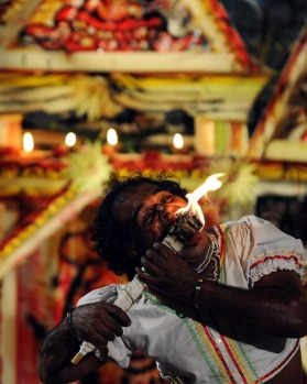 A Sri Lankan traditional dancer performs in Colombo in a ceremonyto ward off bad spirits in the 2012 New Year.