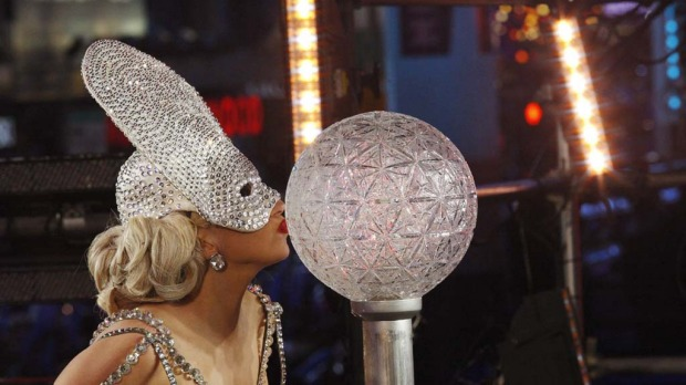 Singer Lady Gaga kisses a crystal ball after performing during New Year's Eve celebrations in Times Square in New York.