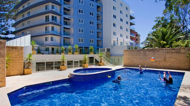 Affordable luxury ... pool and spa at Sandy Cove Apartments.