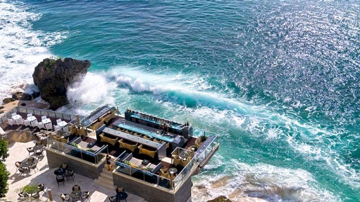 Rock Bar at the Ayana Resort and Spa. The minimalist design of this bar makes perfect use of the rocks on which it sits, ...