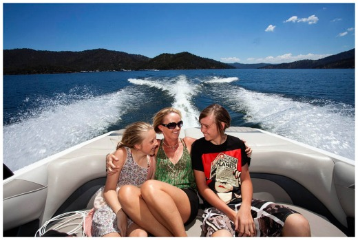 L to R Madison Henwell, Linda Courtney and Cambell Courtney heading towards their houseboat on lake eildon