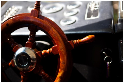 Photograph shows. steering wheel iof houseboat