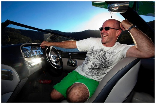 Noel Courttney on his speedboat in lake eildon