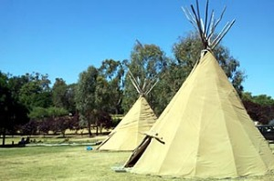Teepees among the blossoms ... Wakiti Creek Resort.