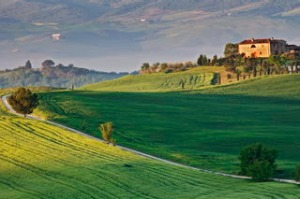 a dirt road leads to this villa near the village of Pienza in Val d'Orcia (a World Heritage Site); Tuscany, Italy.