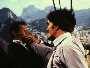 Roger Moore, as Bond, does battle with Jaws in Rio de Janeiro.