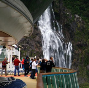 Guests take in Bowen Falls from Radiance's back deck.