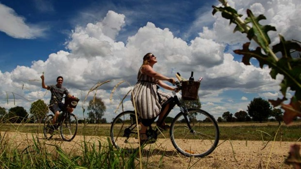 Alicia Noble and Geoff Alexander cycling around the Brown Brothers vineyard in north-east Victoria, which provides free ...
