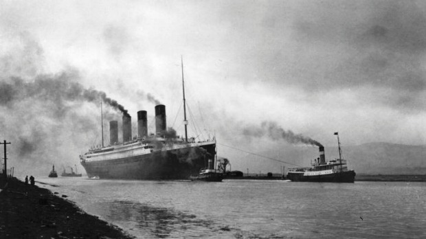 The SS 'Titanic', leaving Belfast to start her trials, pulled by tugs, shortly before her disastrous maiden voyage of ...