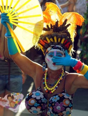 A reveller performs during the Banda de Ipanema Carnival street band parade.
