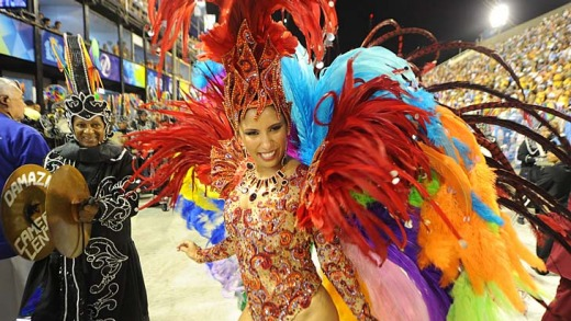 A reveller of Renascer samba school warms up before parading at the Sambadrome in Rio de Janeiro.