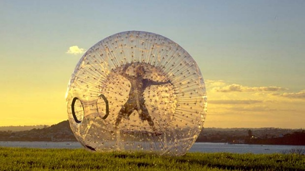 Having a ball ... zorbing by the lake.