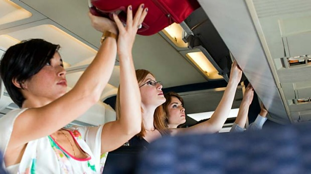 Overheads ... excess cabin baggage can cause delays, frustration and injury.