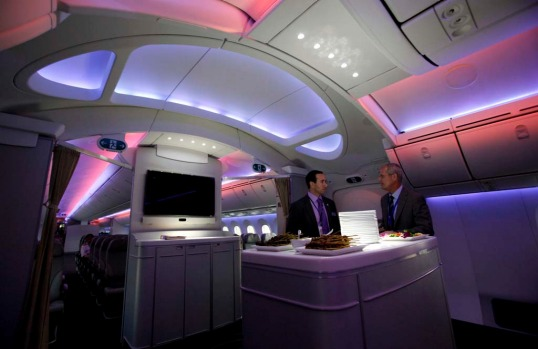 Mark Jenks (R), Boeing's vice president of 787-9 development, speaks to an executive along the archway of the 787 ...