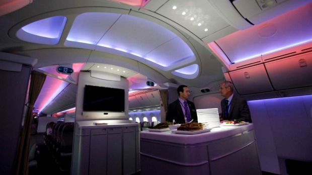 Mark Jenks (R), Boeing's vice president of 787-9 development, speaks to an executive along the archway of the 787 Dreamliner during a demonstration flight.