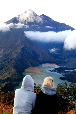 Peak practice ... trekkers enjoy the view of Mount Rinjani.