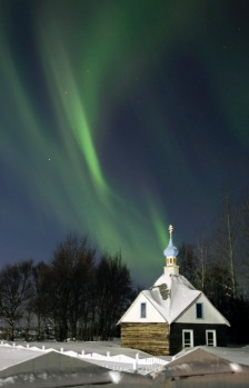 The Northern Lights or aurora borealis fill the western sky Friday, March 9, 2012, above the Russian Orthodox Saint ...