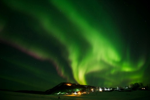In this Friday, March 9, 2012 photo, an aurora borealis swirls in the sky over the Yukon River village of Ruby, Alaska, ...