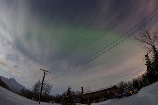 The Aurora Borealis is pictured above a house along the Old Glenn Highway, Alaska.
