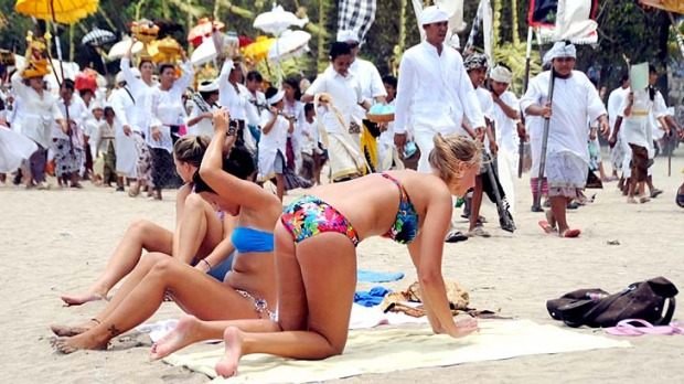 Some travel agents think Bali, where tourism-dependant locals conceal their annoyance at foreigners' behaviour, is ...