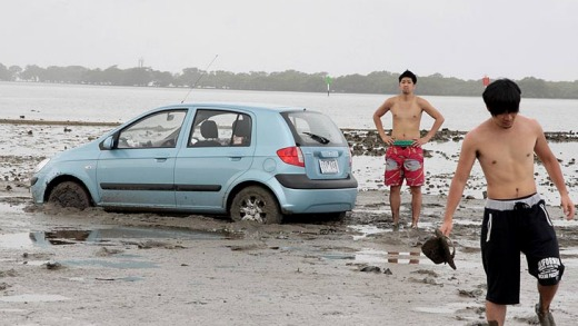Red-faced tourists abandon their car in Moreton Bay.