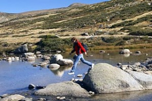 Higher calling ... a hiker crosses Snowy River.