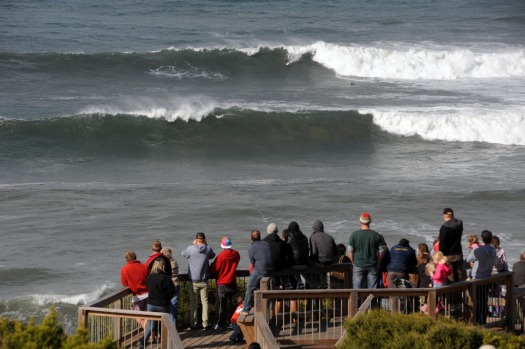 Crowds gather at Bells Beach to get a view of the local surfers taking on the big swell.