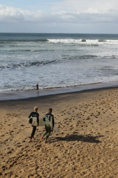 Surfers at Bells Beach, Victoria.