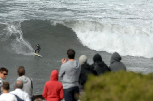 Crowds gather at Bells Beach to watch surfers take on the big swell on Saturday 24th March 2012.