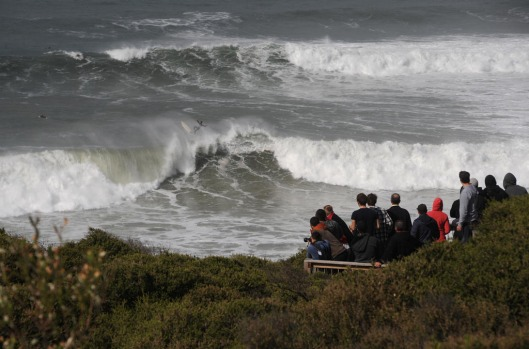 Crowds gather at Bells Beach to watch surfers take on the big swell.