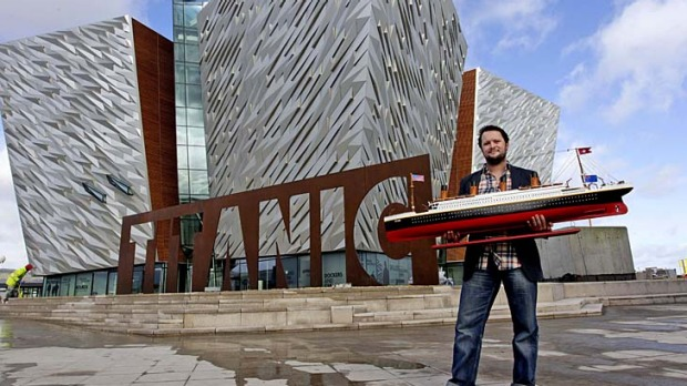 Justin Lowry with his model outside Belfast's Titanic attraction.