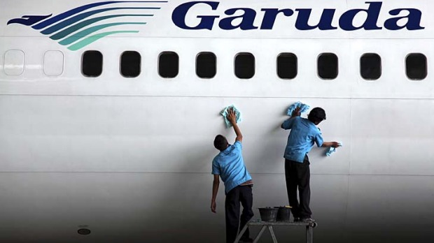 Spruced up ... a Garuda plane undergoes maintenance at Soekarno-Hatta International Airport.