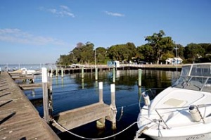 Water world ... guests at McMillans of Metung can moor their boats at the resort's private marina.