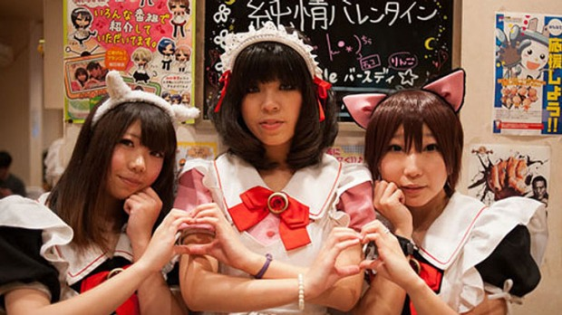 Young employees at a Meido cafe in Osaka, Japan.
